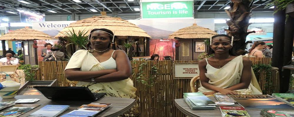Wildlife-Tours-Rwanda-Ladies-at-Stand