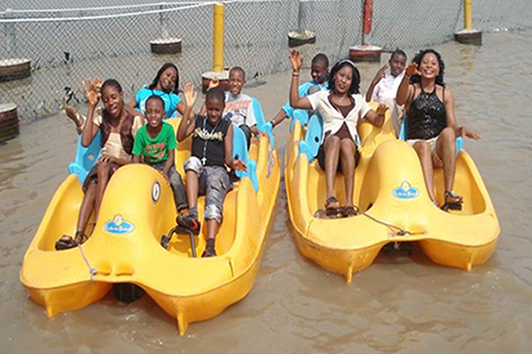 Whispering Palms Resort-Family on a Sport Paddling Boat